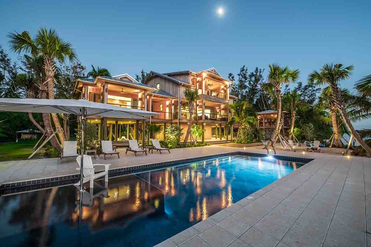 Florida House with full moon rising over pool and home